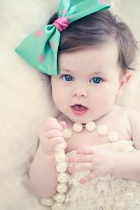 Baby girl with big bow and pearls