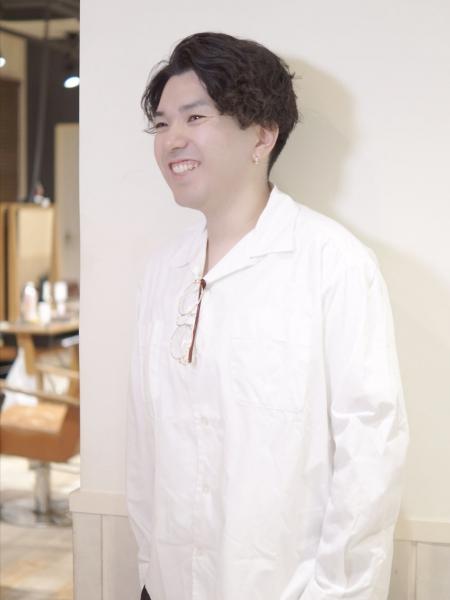 津田 圭介